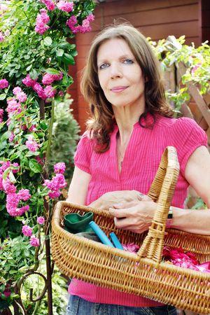 Woman doing gardening, rose-tree and utensils Stock Photo - 3247969