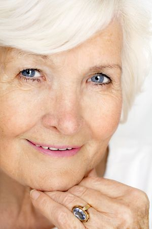 Gracious senior lady portrait with hand on chin Stock Photo