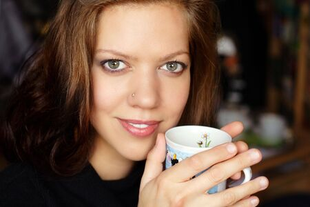 Pretty woman having a cup of coffee Stock Photo - 3307403