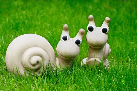 Two stone snails sitting on grass Stock Photo