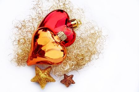 Two heart-shaped christmas bowls on white Stock Photo