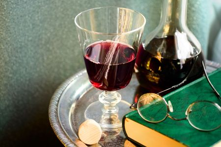 Bottle of red wine with book, eyeglasses,wineglass on a silver tray Stock Photo - 3404820
