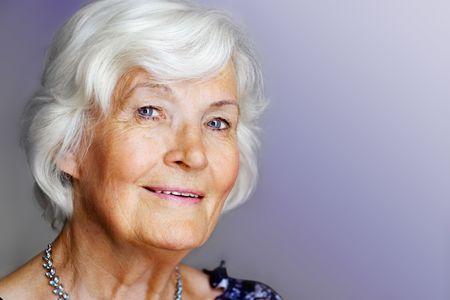 Elegant senior lady portrait with necklace