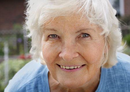 cordial: Natural senior woman portrait, outdoor