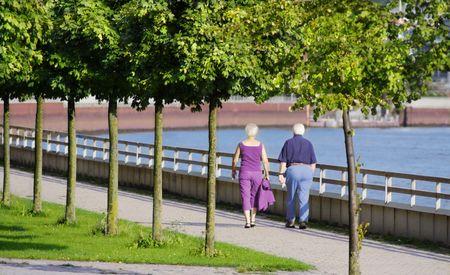 Senior couple at a sidewalk on a riverside Stock Photo - 3499235