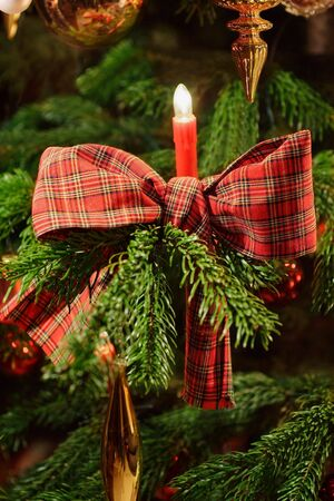 Candlelight and ribbon on christmas tree Stock Photo - 3525916