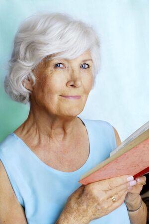 Senior woman reading a book Stock Photo