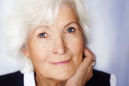 Senior woman portrait on blue background