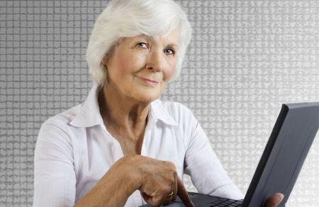 75s: Senior lady and laptop