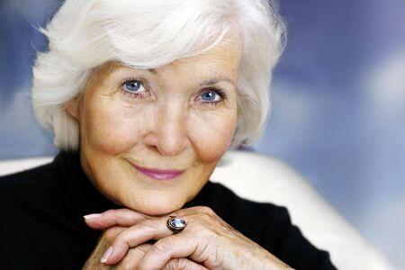 Secretly smiling senior lady portrait Stock Photo
