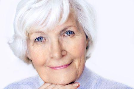 Senior woman portrait, on white background with white hair  Stock Photo