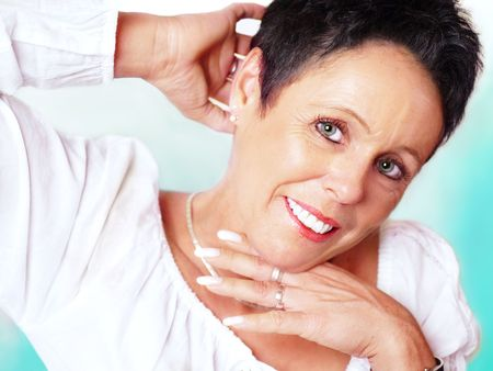 Mature woman portrait on mint background, holding hand behind the head Stock Photo - 4810417