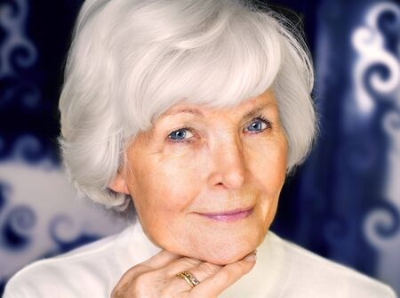 Senior woman portrait,  on  blue curly  background with white hair