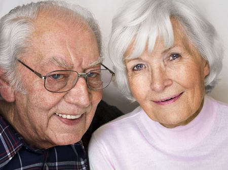 gracious: Happy senior couple smiling for a portrait