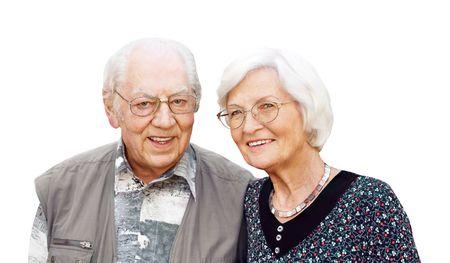 Happy senior couple with eyeglasses on white background