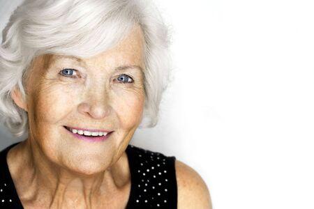 Senior woman portrait, on white background with white hair  Stock fotó