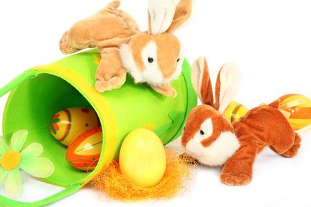 bluster: Two soft toy easter bunnies  playing with an easter egg, isolated on white background