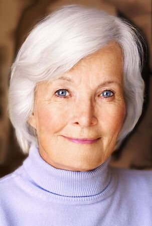 Senior woman portrait  with white hair and blue pullover