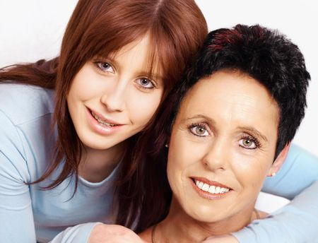 Teenage daughter embraces mature mother    Stock Photo - 6489389