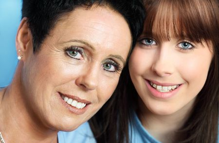 nearness:  Teenage daughter and  mature mother portrait, close up