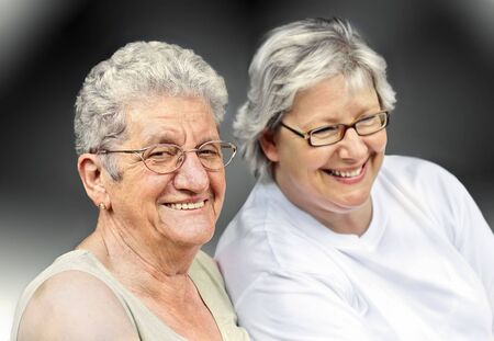 Senior woman portrait, on  grey background with white hair  Stock Photo - 7806937