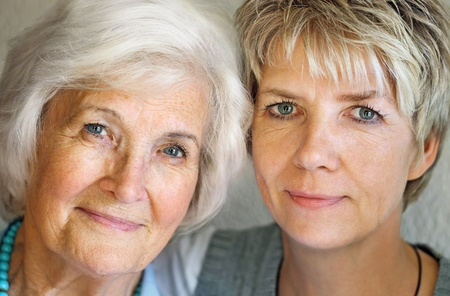 amiable: Senior woman and mature daughter portrait Stock Photo