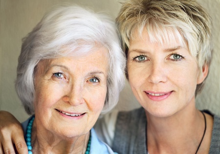 mature old generation: Senior mother and mature daughter portrait, 25 years between them