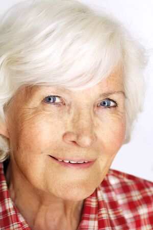 gracious: Senior woman portrait, on white background with white hair  Stock Photo