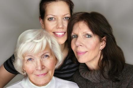 belonging: Senior woman and mature daughter and granddaughter portrait