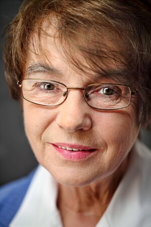 gracious: Senior woman portrait,  naturally and with eyeglasses