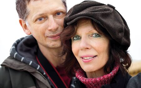 Mature couple portr�t,outdoors with jacket and cap Stock Photo - 12926455