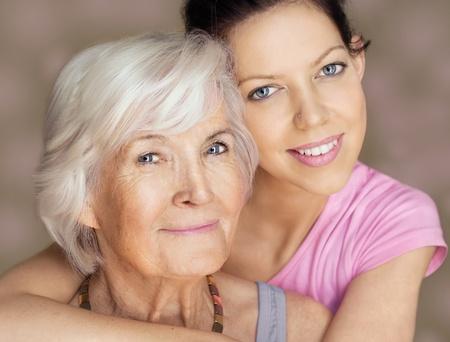 elderly care: Grandmother and granddaughter portrait, embraced