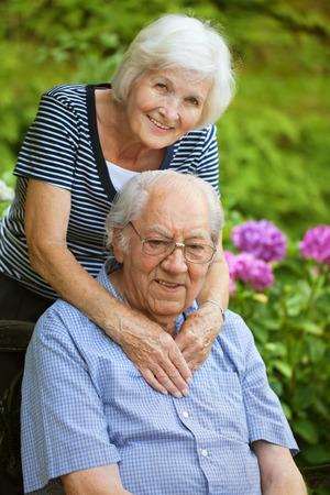 Happy senior couple in the garden photo