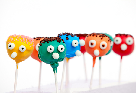 cake pops: Six cake pops with funny faces isolated on white background