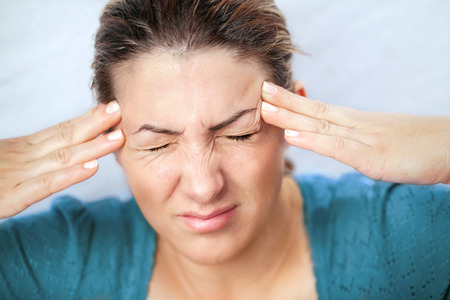 woman headache: Woman holding hands on her head, depression, pain, migraine