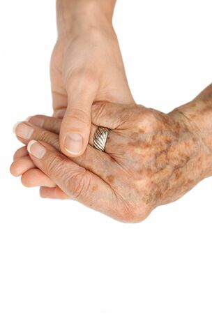 Old hand holding young hand