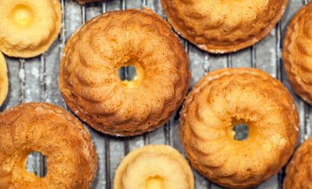 Many  small pound cakes on a baking tray Stock Photo