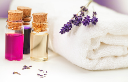 Lavendula,towel and oil for massage on white background