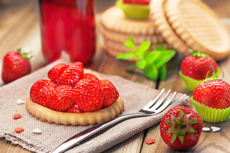 Strawberry biscuit  on a wooden background