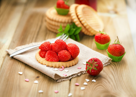 Strawberry biscuit on wooden background