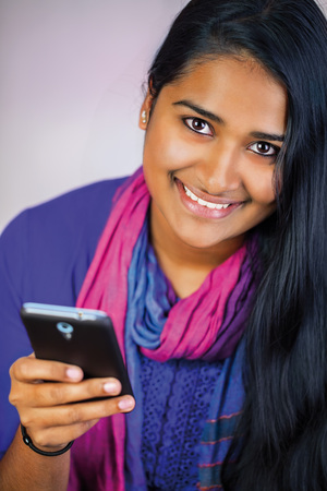 Young beautiful india woman with smartphone , big smile with long hair and teeth