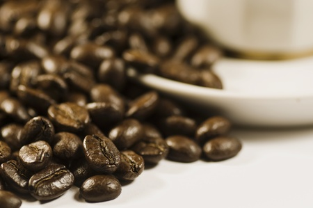 Coffee beans on white background by saucer cup Stock Photo - 8278852