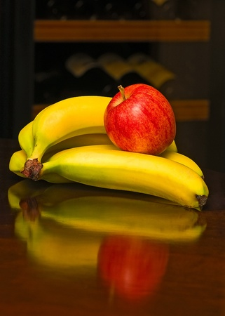 apple and bananas with reflection Stock Photo - 8278857