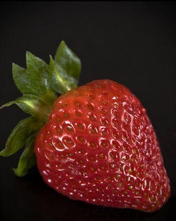 Starwberry close up on black background Stock Photo - 8287660