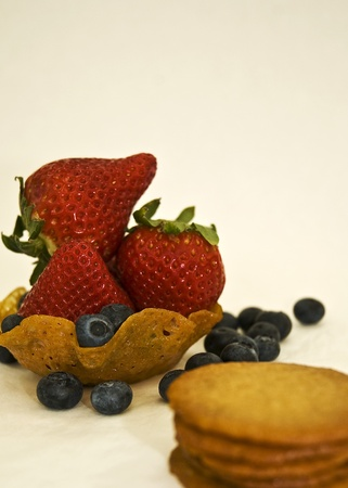 berries and ginger snap cookies