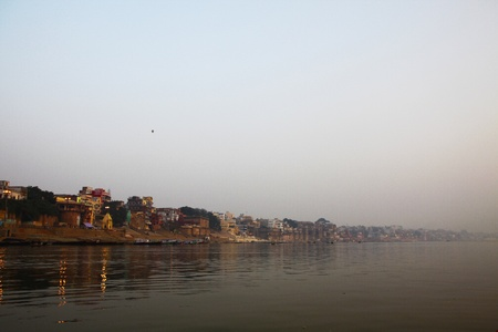 Early morning sunrise panorama of the serene river Ganges near Varanasi, India photo