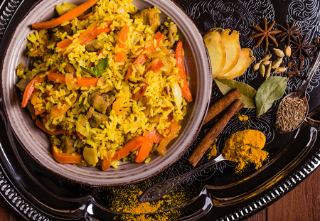 biryani: Indian Biryani with chicken and spices in traditional style