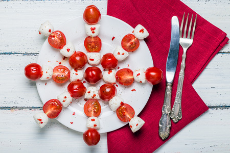 Caprese salad on a light background