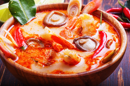 thai ethnicity: Thai Tom Yam soup with shrimp and mushrooms, served with lime and rice