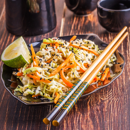 healthy meals: Salad with cabbage and carrots in the Asian style. Stock Photo